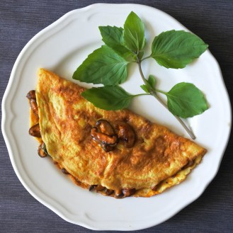 omelette filled with Thai chile mushrooms garnished with Thai basil