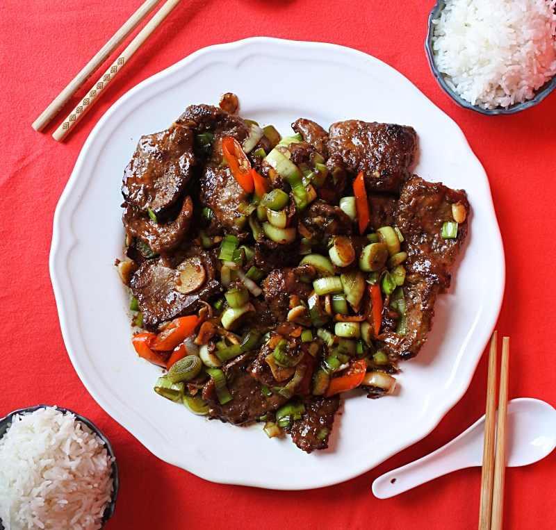 Chinese style liver and onions with rice, chopsticks and spoon