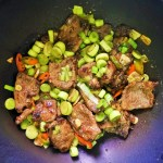 beef liver, leeks and chiles frying in wok