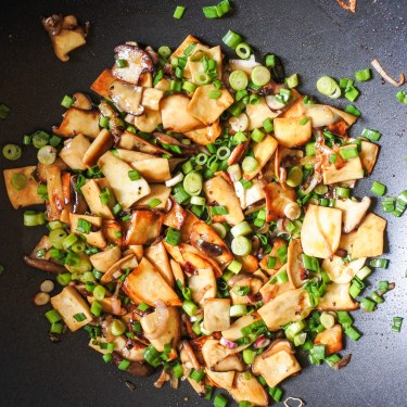 mushrooms cooking with shallots and scallion in pan