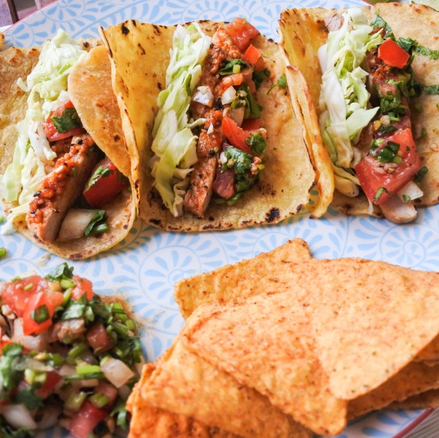 For assembly, place 2-3 pork slices in a corn tortilla alongside a sprinkling of cabbage and salsa. Enjoy!