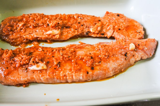 raw pork covered in marinade