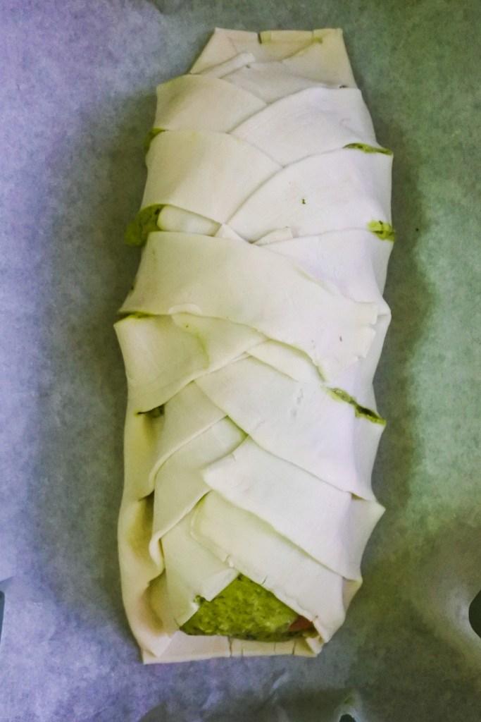 raw salmon en croute on baking tray
