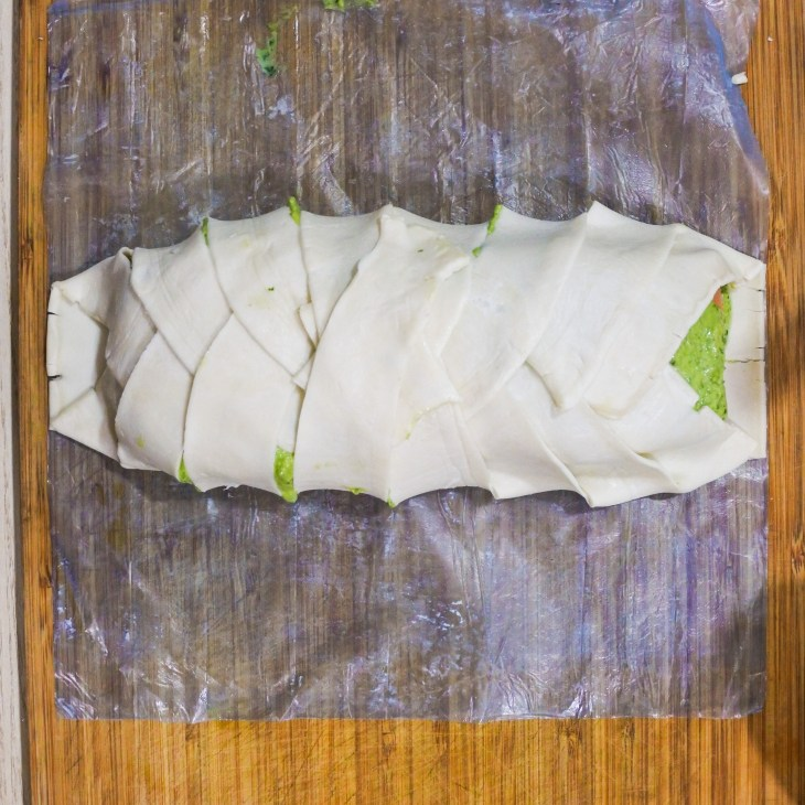 puff pastry folded around salmon fillets
