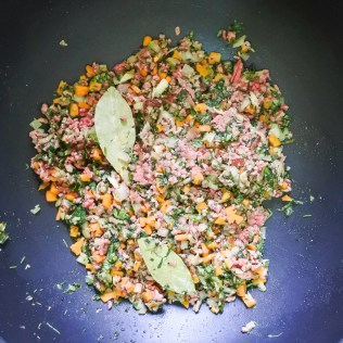 Add minced beef and chopped herbs