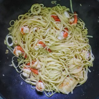 Toss in cooked linguine and drizzle with 1 tbsp lemon juice and pasta water/seafood stock.