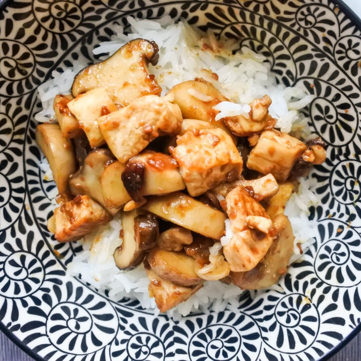 Tofu and Mushroom stir fry in soybean sauce over steamed rice