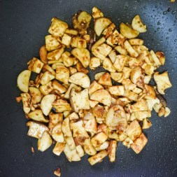 tofu and mushrooms frying in soybean sauce