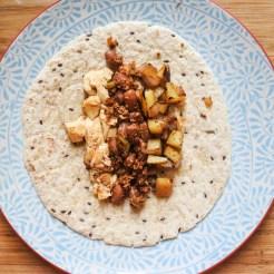 breakfast burrito ingredients in tortilla