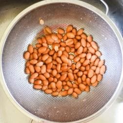 beans draining in metal colander