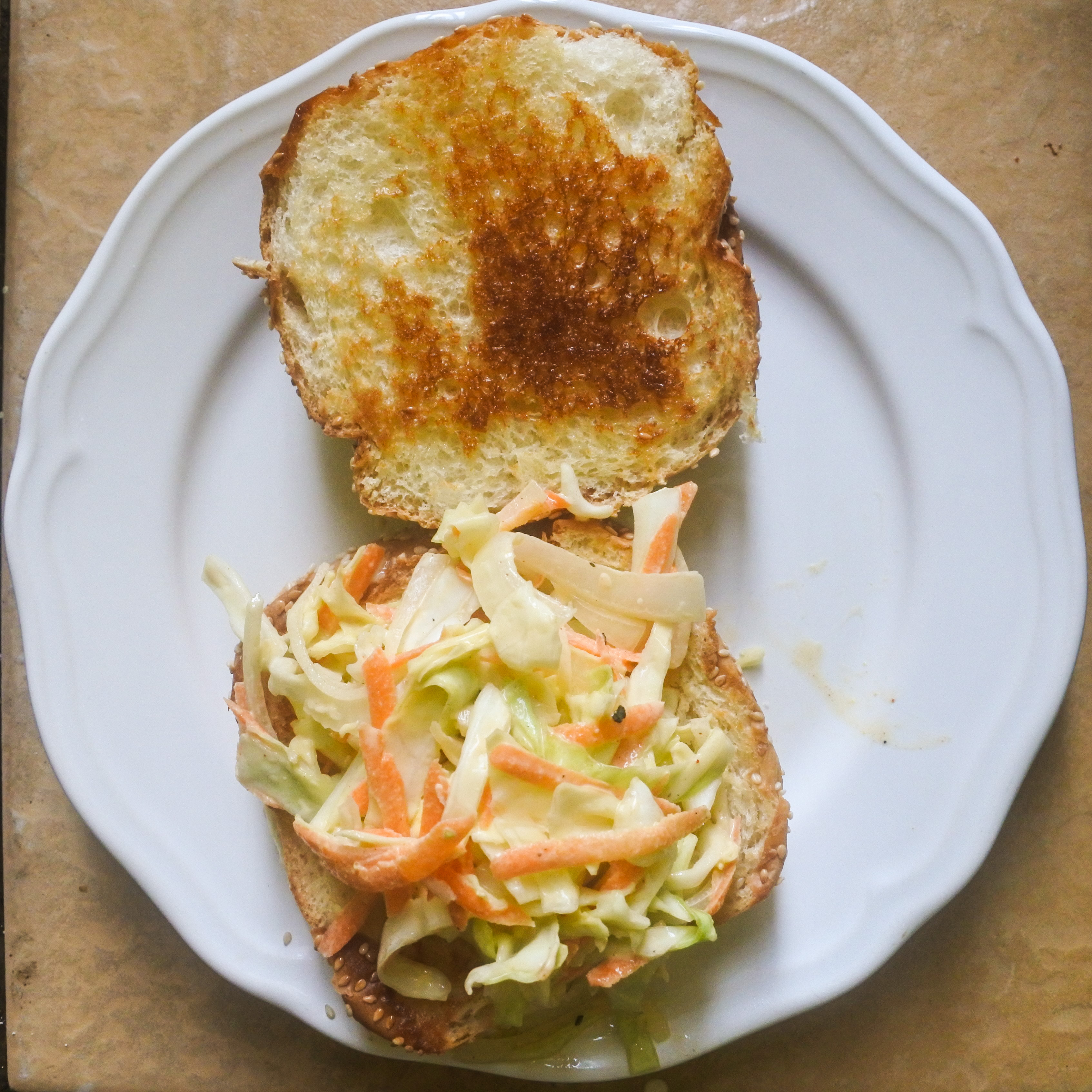 Place a spoonful of coleslaw on the bottom half