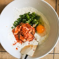 Mix together flour, sugar, salt, chopped scallions, apple cider vinegar and kimchi.