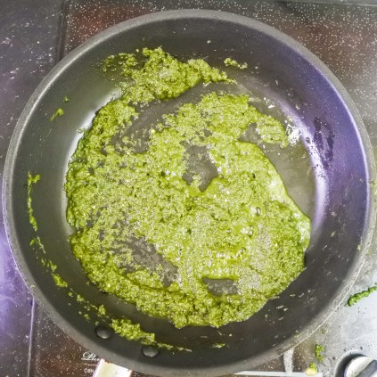 Cook until cilantro mix has darkened, most of the moisture has evaporated and consistency has changed to a creamier texture.