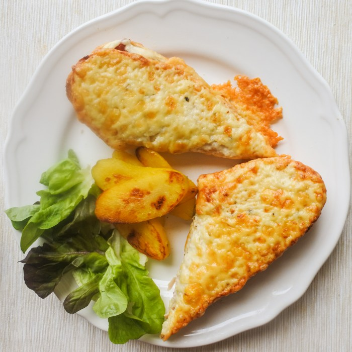 Croque Monsieur, potato frites and lettuce on a plate