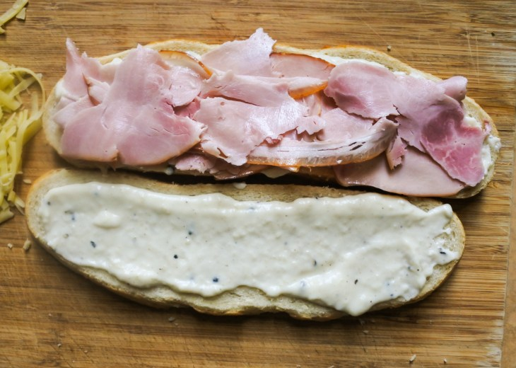 sliced bread covered in Bechamel sauce and topped with sliced ham
