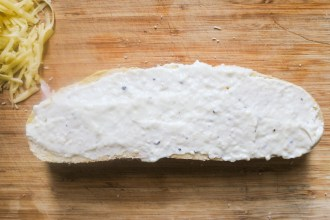 Bechamel spread over sandwich top
