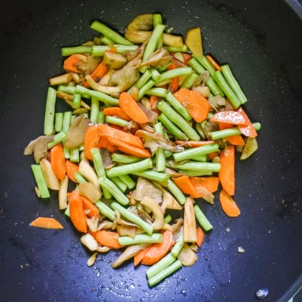Then add sliced carrot and green beans.  Stir-fry for 3-4 minutes over high heat.
