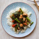 Lemongrass chicken stir-fry atop steamed jasmine rice on a plate