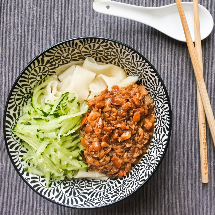 a bowl of Chinese soybean noodles with grated cucumber