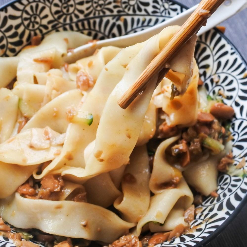 chopsticks pulling a Zha Jiang Mian noodle