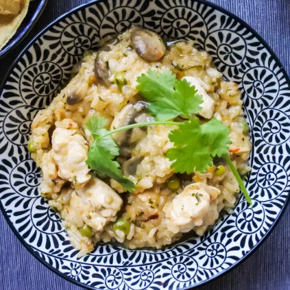 chicken, mushrooms and peas cooked with salsa and rice garnished with cilantro