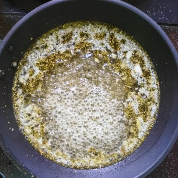cider, sage, garlic and butter cooking in a pan