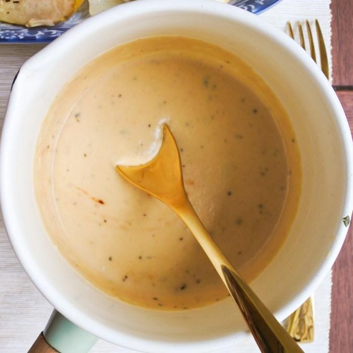 a saucepan full of Dijon and cider cream sauce