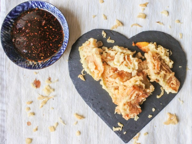 Pumpkin Tempura on a heart shaped plate served with a chile vinegar and soy sauce