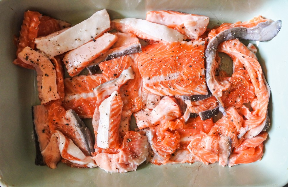 Raw salmon scraps in an oven tray