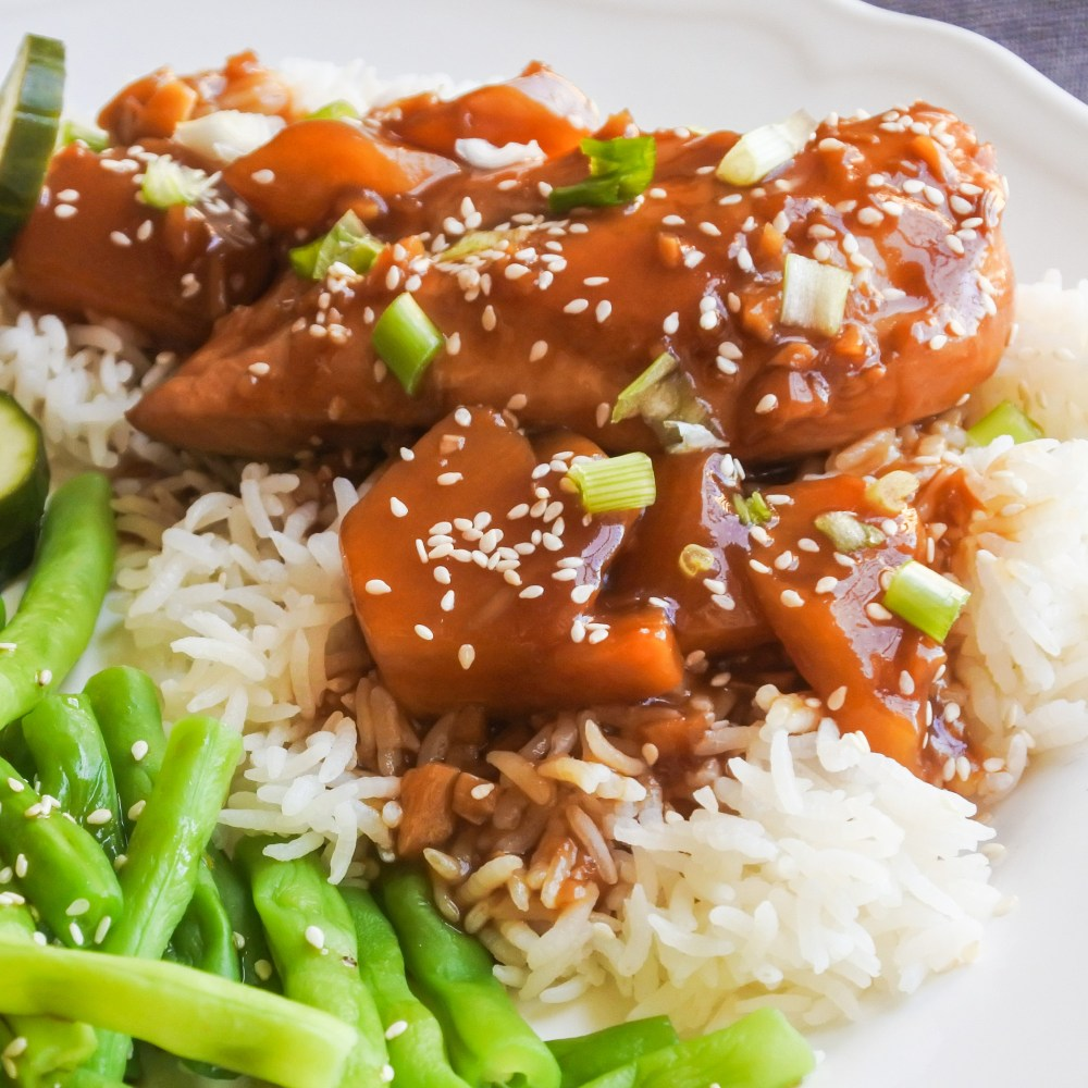 meat and fruit in a soy glaze over jasmine rice with sesame green beans