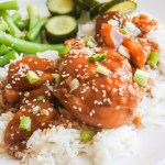 Chicken and pineapple in a soy glaze over jasmine rice with sesame green beans and pickled cucumber