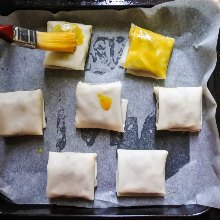Stuffed spring roll parcels brushed with turmeric butter