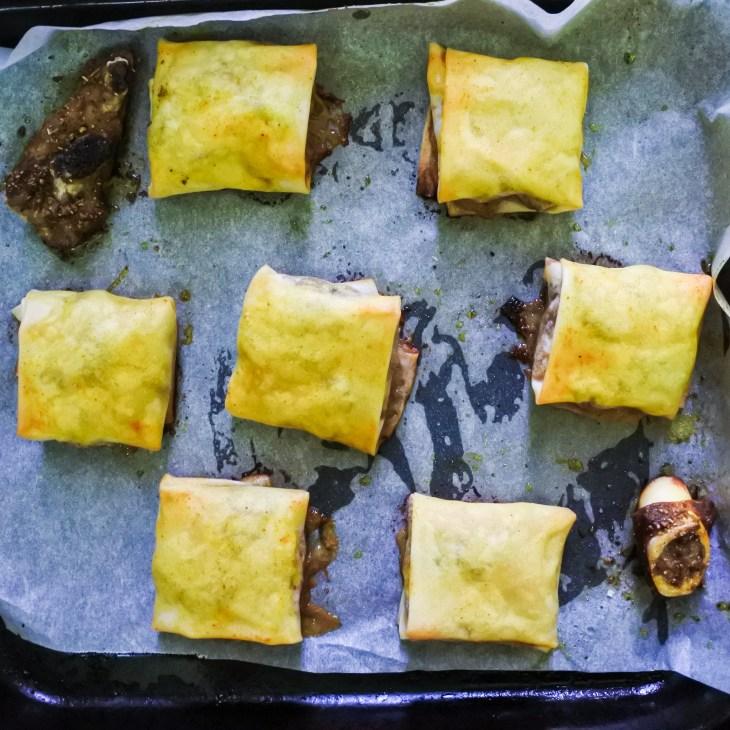 Baked Uyghur lamb parcels on a baking sheet