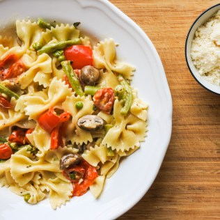Toss to combine and serve with a dusting of good cheese like fresh Parmesan or Asiago cheese.