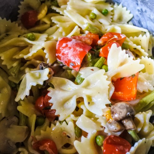 Farfalle pasta tossed with roasted vegetables and cream