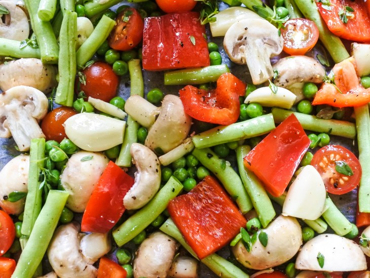 Cut raw vegetables on an oven tray