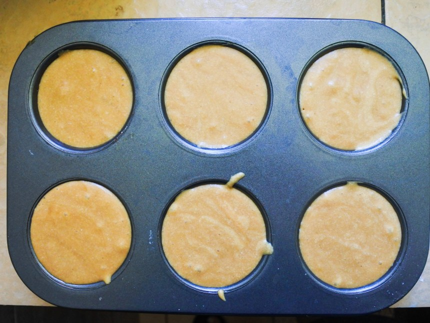 muffine tins filled with dulce de leche cake batter