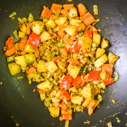 Once vegetables have softened, add turmeric, cumin, coriander and cardamon. Stir and cook until fragrant (about a minute or so)