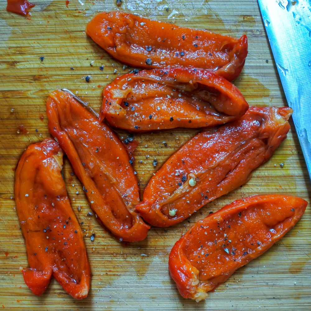 Strips of roasted red bell pepper seasoned with vinegar, salt and pepper