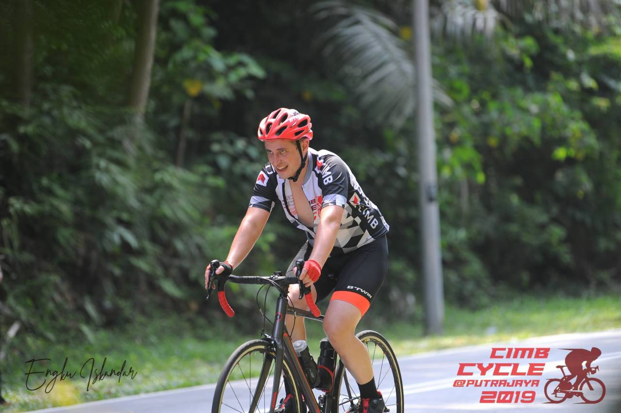 Cyclist suffering in heat on the CIMB Cycle ride
