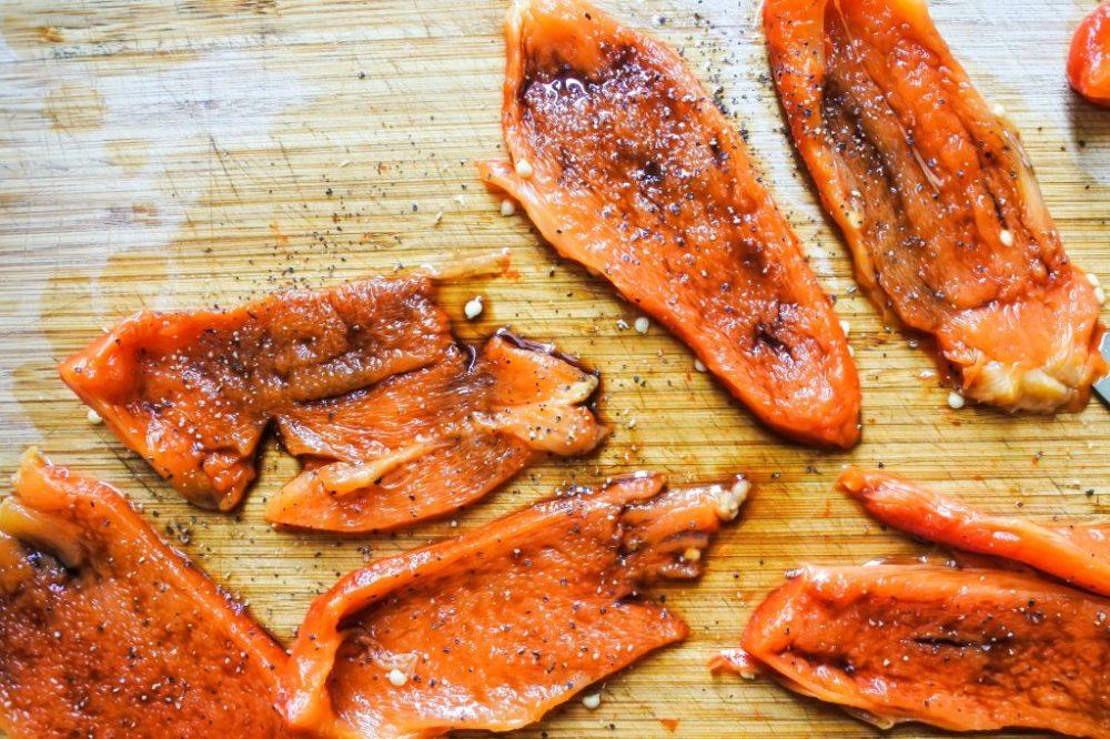 Slices of roasted red pepper seasoned with Balsamic vinegar, salt and black pepper