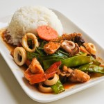 Seafood Nam Prik Pao on a plate with steamed jasmine rice