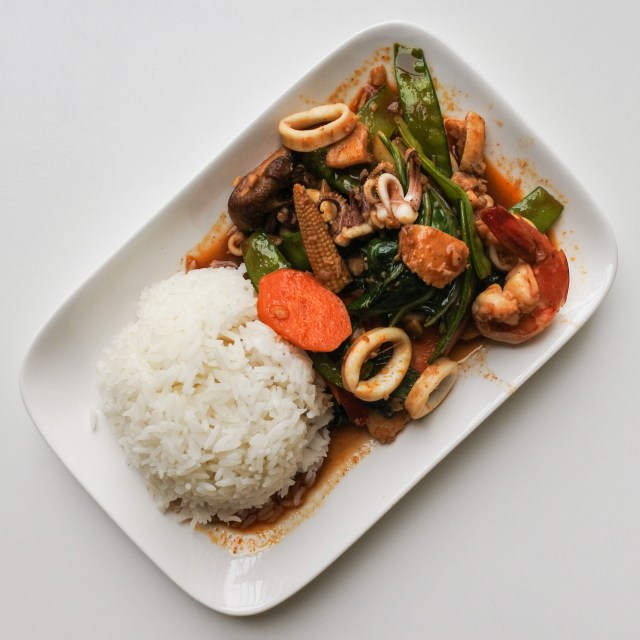 Squid, prawns and fish with stir fried vegetables in a red Thai Chile sauce served with a mound of Jasmine rice