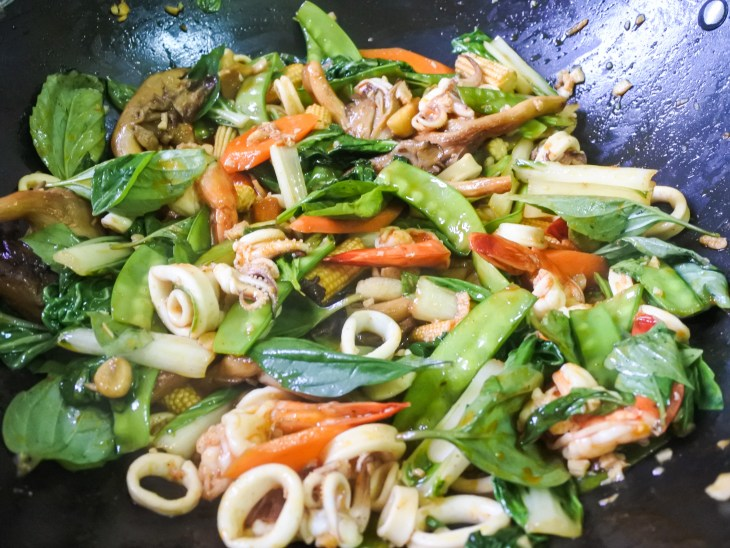 Thai Basil topping a seafood and vegetable stir fry