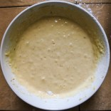 Slowly, sift in the dry ingredients and mix together.  Try not to over mix, leaving the batter thick and slightly lumpy.