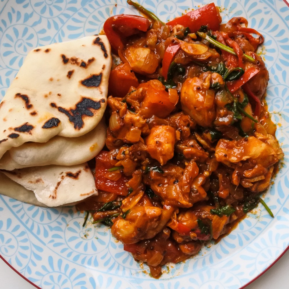Chicken balti on a plate with naan