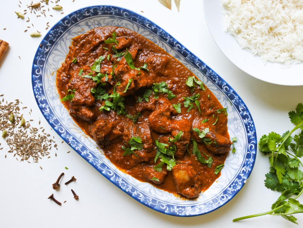 Rogan Josh Curry with steamed Basmati Rice, cilantro and spices
