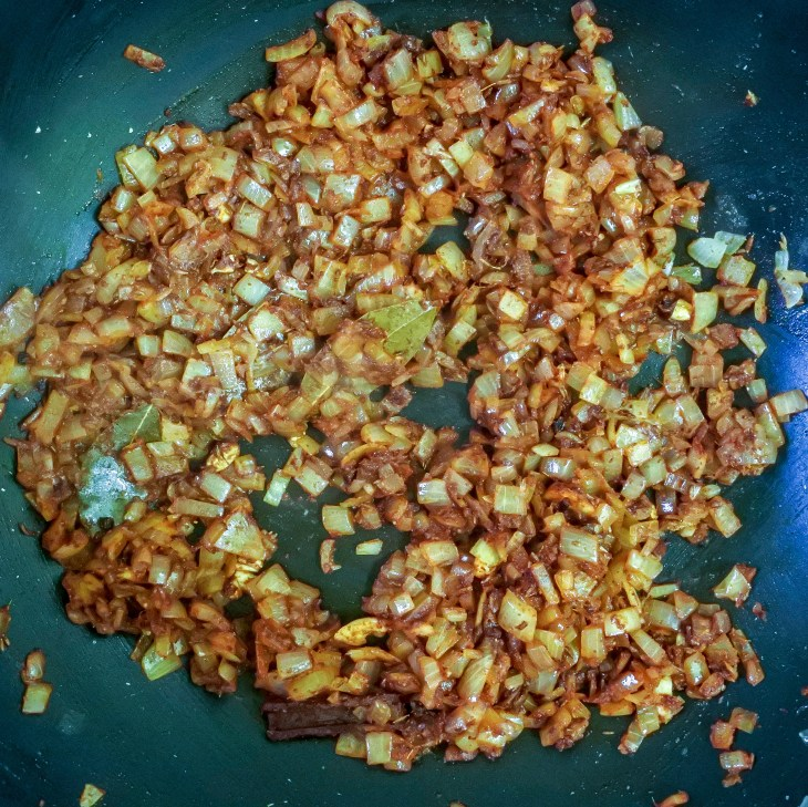 diced onions frying with spices and ginger/garlic paste