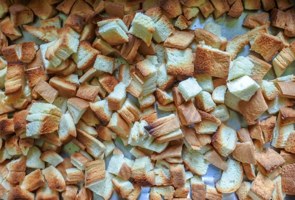 toasted white bread pieces in an oven tray