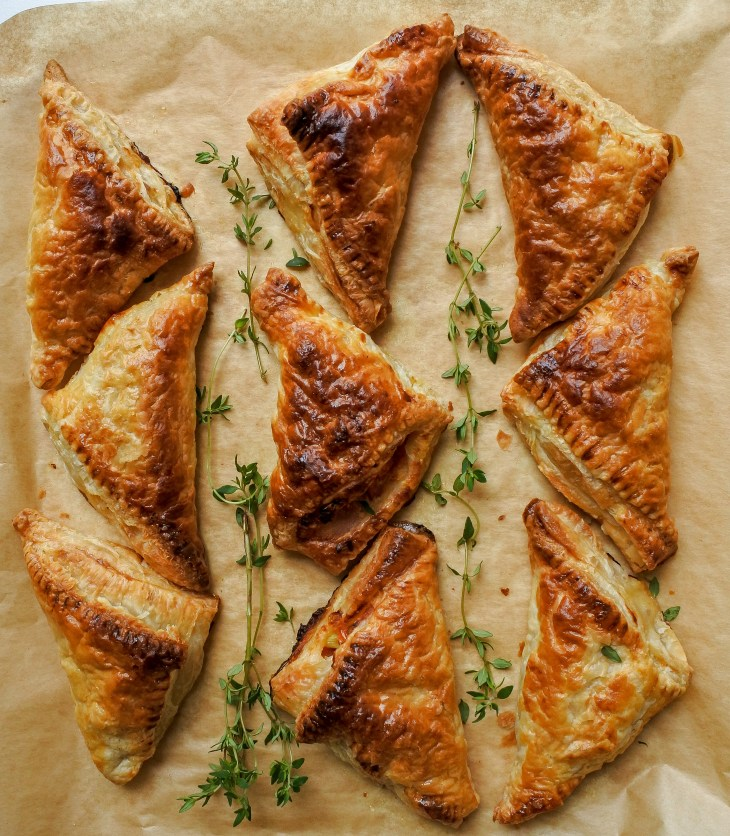 chicken and bacon puffs on paper with fresh thyme sprigs